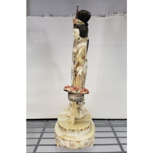 Up for sale is an Early 20th Century Japanese Kuan Yin Performing Blessing Okimono Bovine Bone Carving! It measures 11...