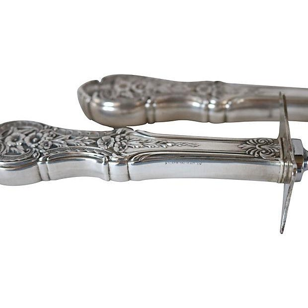 """Large 1920s carving set with heavily detailed sterling silver handles. Fork, 11.25""""L x 1.75""""H; knife, 13.5""""L x 1.75""""H...."""
