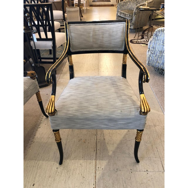 Super elegant set of 6 glamorous black and gilded armchairs that define Regency design. Delicate paw arms and a rolled...