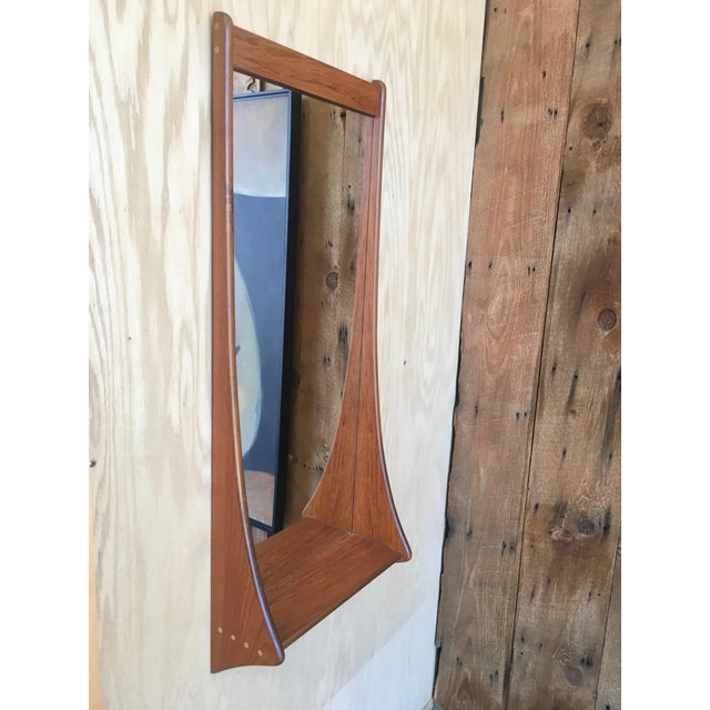 Mid century walnut foyer mirror with dowel decoration. Very mod!