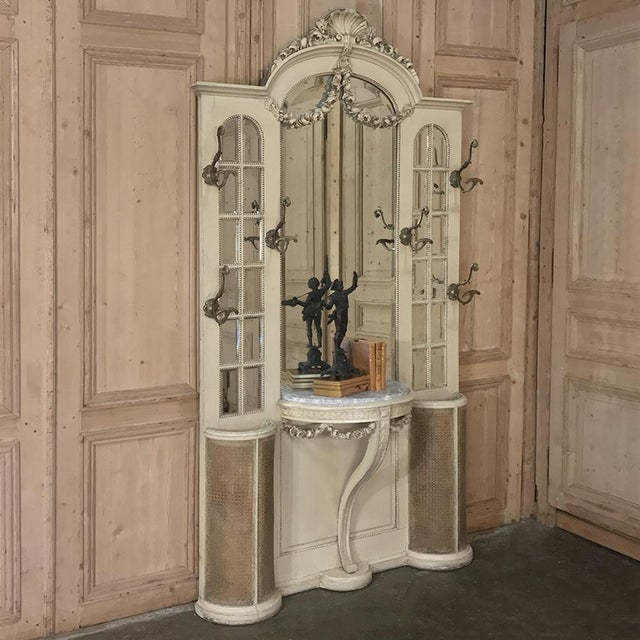 19th Century French Louis XVI Painted Hall Tree is a spectacular example of the classical style, rendered in fine walnut...