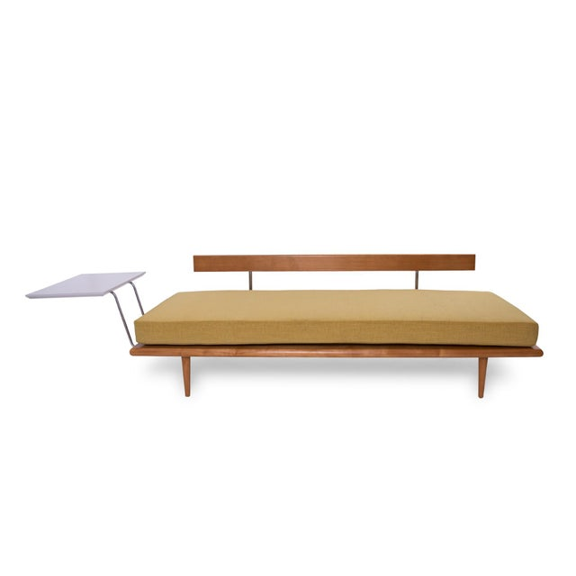 This early 1950s George Nelson for Herman Miller daybed with mustard yellow upholstery features a seldom-seen side table...