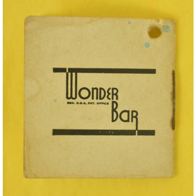 A miniature Wonder Bar cart featuring a Cocktail Recipes Booklet with 16 recipes and 5 unique cocktail picks displayed on...