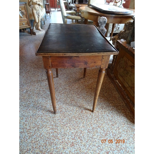 Directoire epoch French walnut side table with leather top. Tapered round legs with one drawer. The leather is in a good...