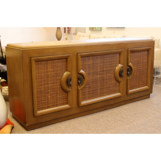 For your consideration is a phenomenal, wood and cane credenza, with three doors and four drawers, Paul Laszlo for Brown...