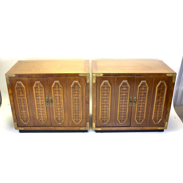 Pair of Mid-century walnut cabinet with brass hardware These cabinet are solid built with double door and middle shelf...