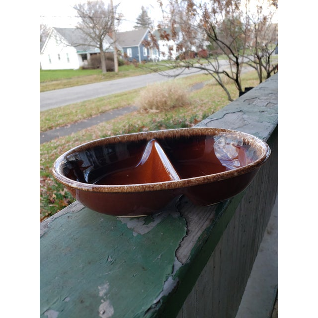 Gorgeous oven proof pottery dish, oval in shape with center divider. Made in USA by Hull Pottery & Co. Done in the rich...
