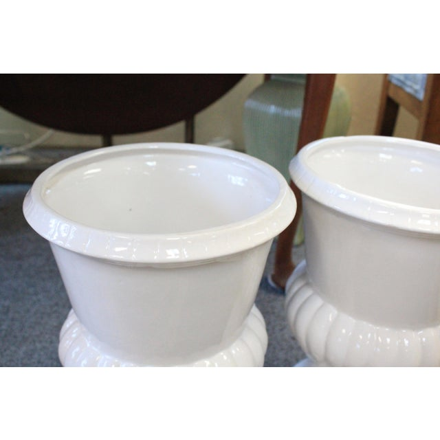 Pair of white ceramic neoclassical urns. Simple and classic!