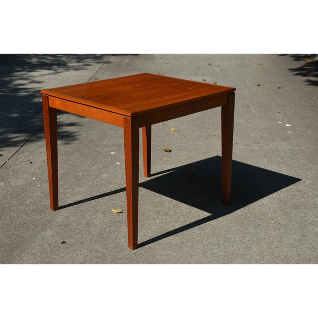 A great little Danish Modern side table from Bent Silberg Mobler of Denmark. Teak with inlay and tapered legs. Will make a...