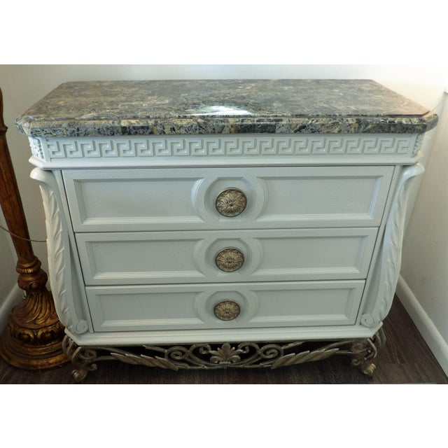 Ornate sideboard credenza with a faux marble top. The three drawer chest features a Greek Key design across the top and...