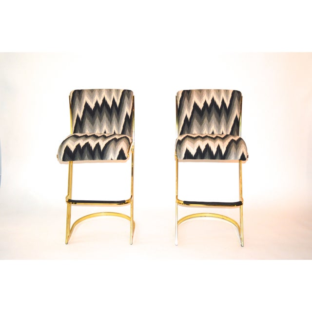 This pair of vintage brass plated steel framed bar stools are absolutely amazing! They sport custom upholstered cushions...