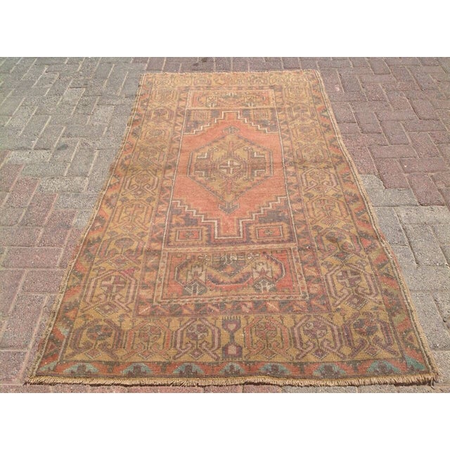 This gorgeous, hand-knotted vintage Anatolian area rug is approximately 60 years old in excellent vintage condition. The...