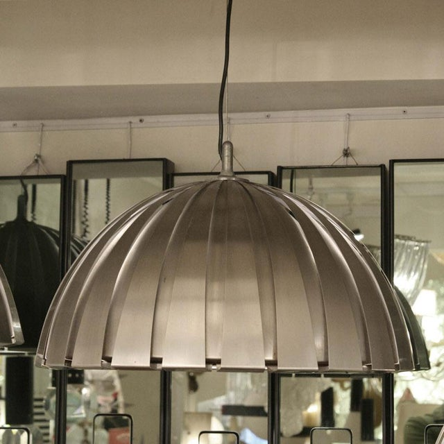 Suspension ceiling lights by Elio Martinelli for Flos, brushed steel. ca.1960 Conditions : Very good MEASUREMENTS Height:...