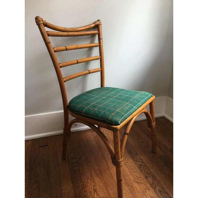 """This charming vintage accent chair is likely hand-made, circa 1940. It features """"scorched bamboo"""", or bamboo that has..."""