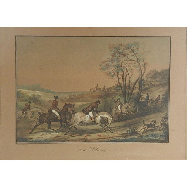 Circa 1850's french equestrian lithograph by Carle Vernet with hand coloring. Hunt scene with horse and riders with dogs,...