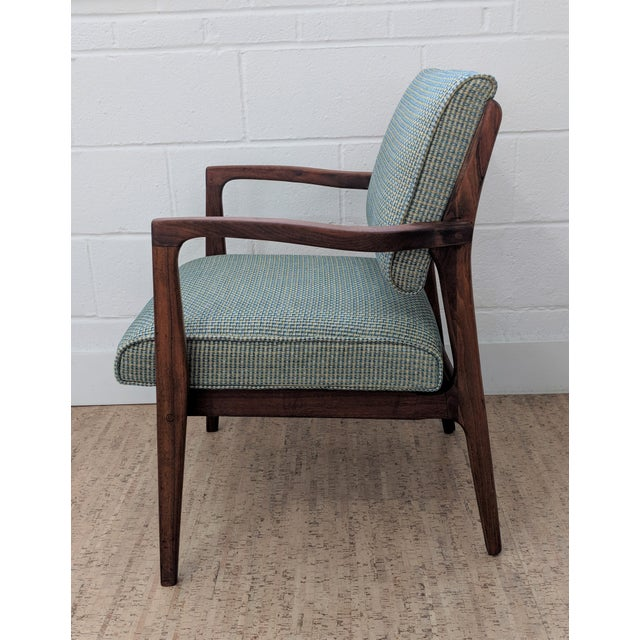 Sink down into this powerful mid-century modern chair. This restored accent chair has strong sinuous lines, is well built...