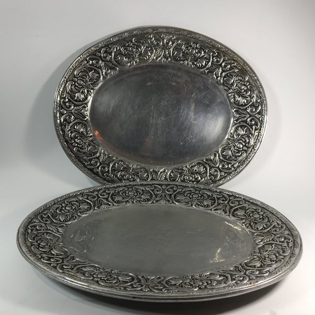 Pair of Wilton armelate hollowware trays scrolled rococo floral motifs enveloping the scalloped center. Marked on a bottom.
