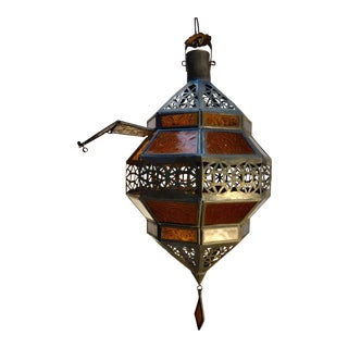 Moroccan Handcrafted Metal and Amber Glass Lantern, Octagonal Diamond Shape For Sale