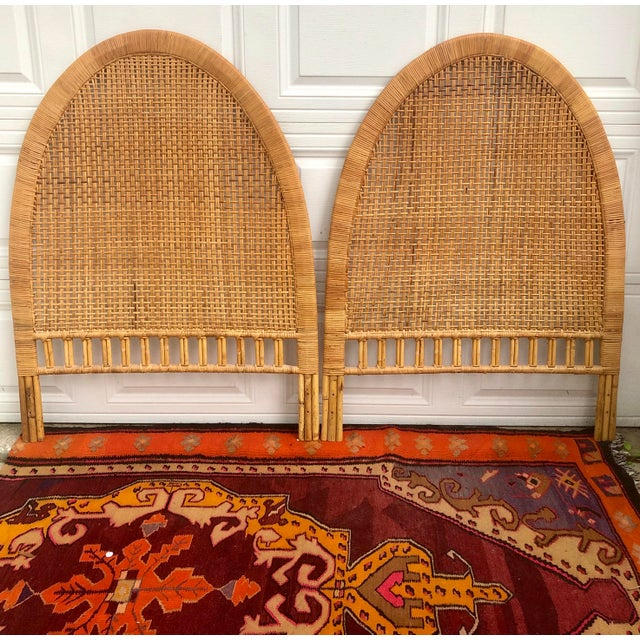 A pair of vintage hand woven and wrapped twin headboards. Caned rattan in natural with bamboo accents. 1960's-70's Palm...