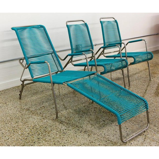 Surf line outdoor patio furniture, 2 lounge chairs, 1 chaise in stainless steel and aqua marine nylon webbing. The beauty...