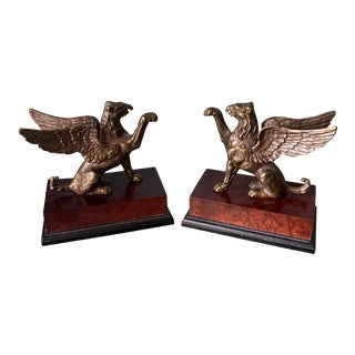 Griffin Bookends on Wooden Bases - a Pair For Sale