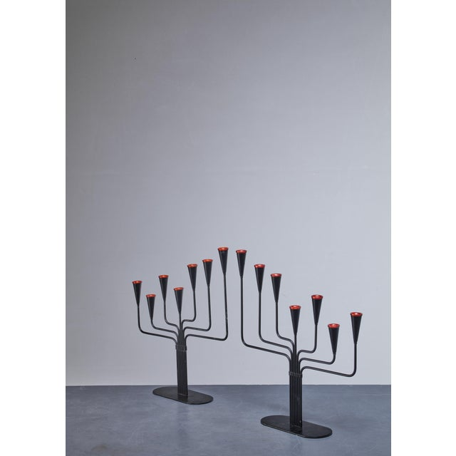 A pair of candelabras for seven candles each, designed by Gunnar Ander for Ystad, Sweden. Black lacquered metal with...