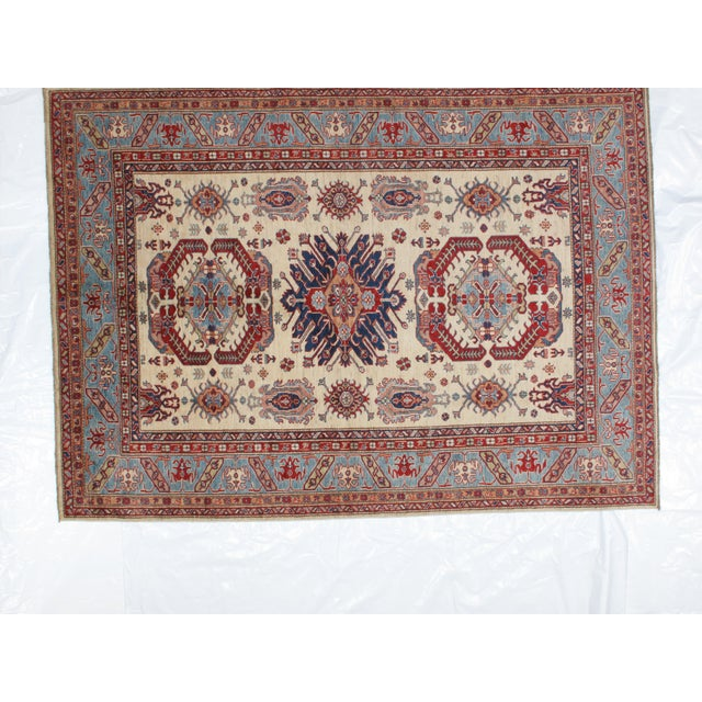 This master piece is a Ghazni wool pile very fine genuine hand woven Super quality Khotan carpet in mint condition.