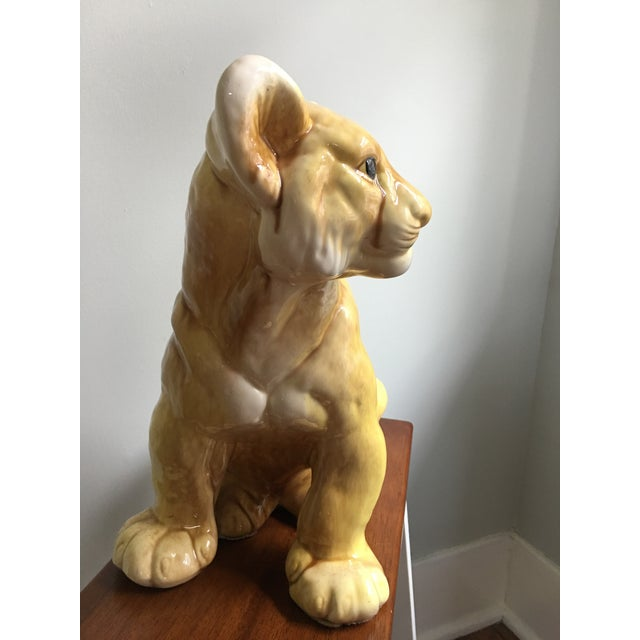 Vintage hand-made glazed ceramic lion cub, presented in life-size scale with incredibly detailed and realistic expressions...
