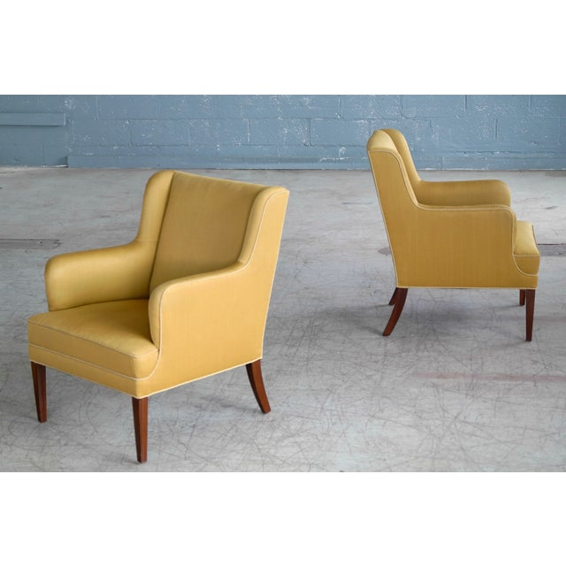 Classic Frits Henningsen lounge chairs made in Denmark circa 1950. Frits Henningsen's elegant and modern style go equally...
