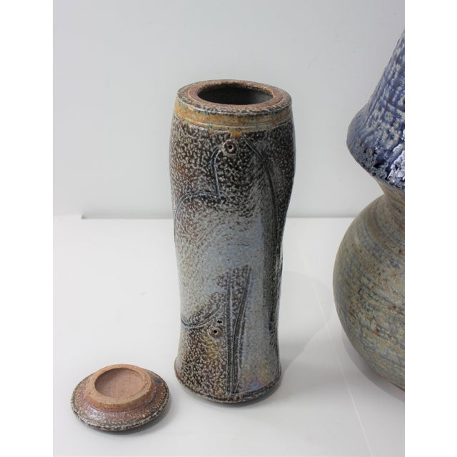 Artisan pottery with visible coil effect on interiors, with expressively applied glazes. The smaller item MAY have a bird...