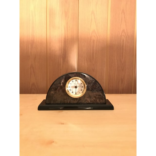 Aigumont Paris desk clock. Beautiful design in Marble like material with a black base.. the battery is behind the clock...