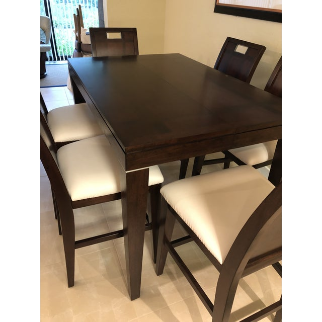 Furnishing a condo or vacation home? Counter-height, espresso-finished designer dining table and six chairs are just the...