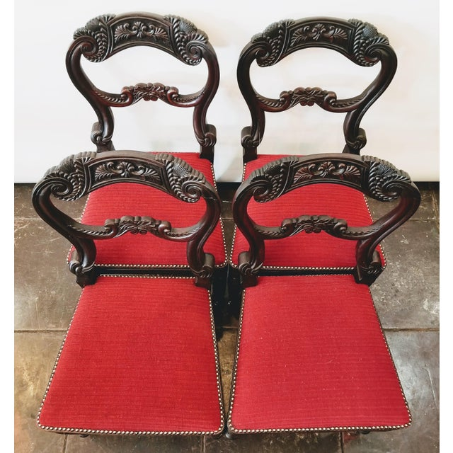 Set of four waisted open balloon back chairs numbered III, V, VIIII, and X, indicating these were once part of a set of 10...