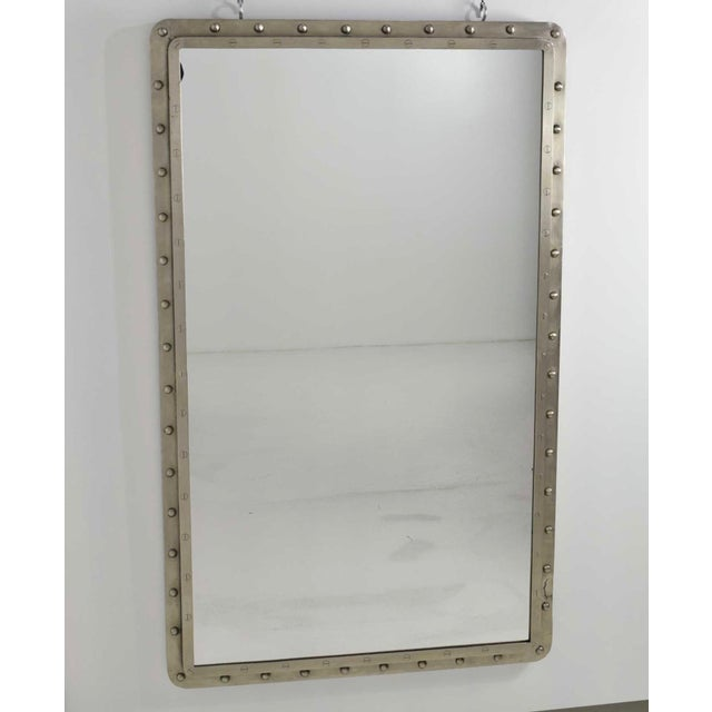 Very large Industrial style iron wall mirrors. Mirrors have rivets with screws around edge, two level frames. Brushed...