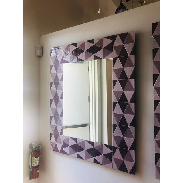 Custom geometric mirror with alternating lavender and mauve triangles which give an optical illusion of depth.