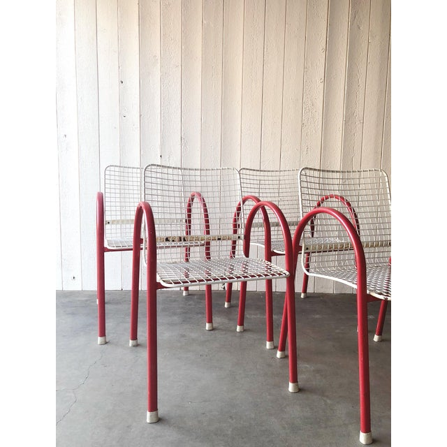 Trendy, post modern, 80's arc and grid patio chairs perfect for a sunroom or the outdoors. Bright red arc arm rests add a...