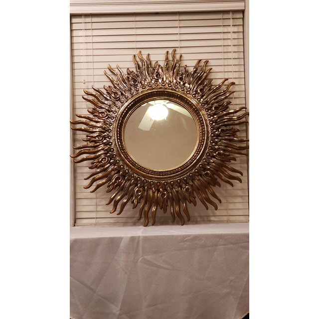 Large Sunburst Frame Mirror with a cast resin faux gilt. This 4ft frame of sunshine has waving rays that surround the 19in...