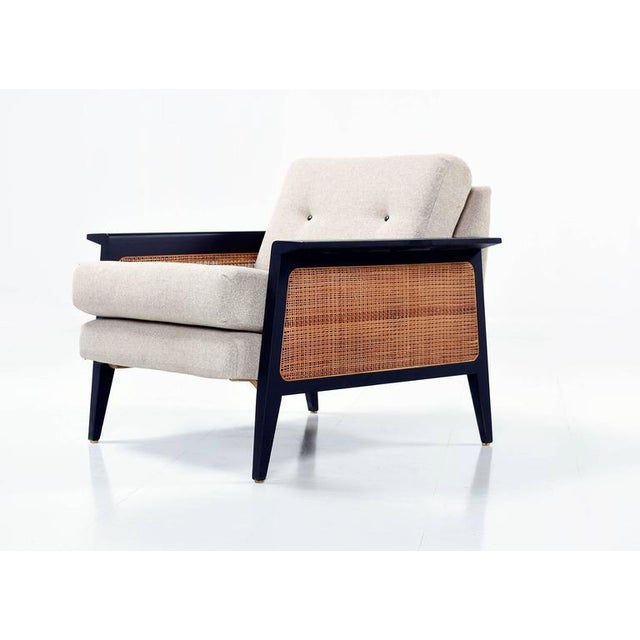 "This mid-century modern chair has been completely overhauled. It is essentially a ""new"" vintage chair. The chair boasts..."