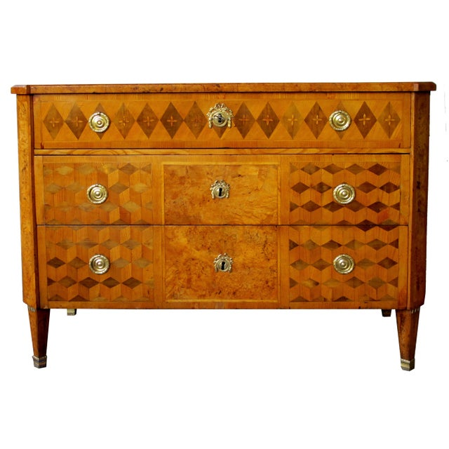 A handsome Swedish Gustavian alder root parquetry 3-drawer chest; the well-figured top with canted corners above a body...