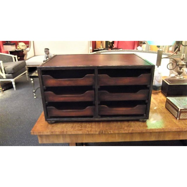 Campaign style Mahogany and leather desk organizer with open drawers. The top is leather, drawers are wood with pierced...