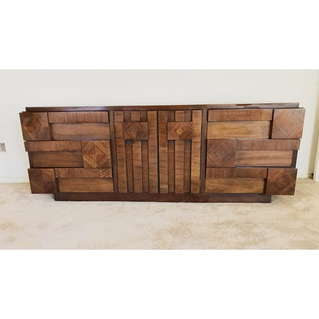 "Gorgeous walnut brutalist dresser gives a sculptural edge to any style room. 78.5"" wide 19.5"" deep 30.5"" tall drawers are..."