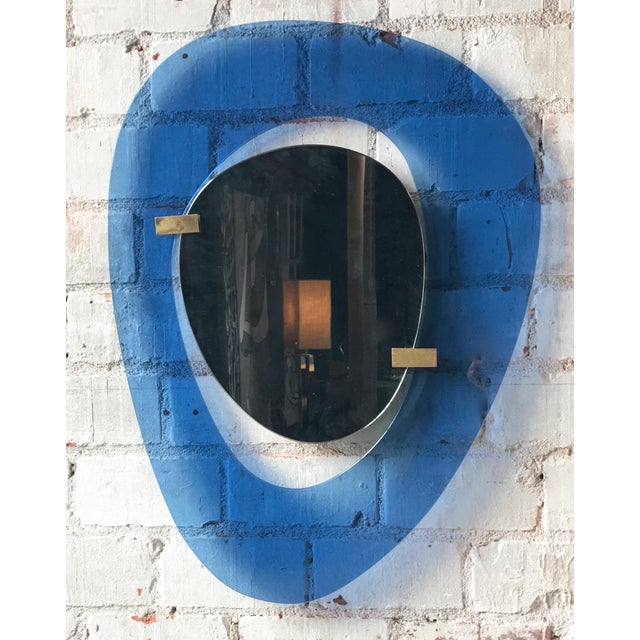 Rare light blue sculptural wall mirror, Italy, 1958. Fontana Arte mirror by Max Ingrand, featuring a sculptural form...