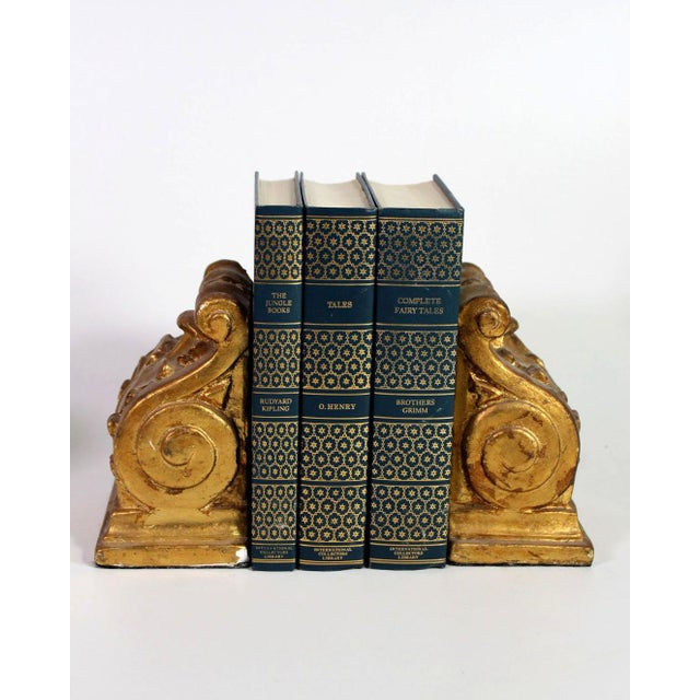 Gorgeous set of two Romanesque scroll bookends, hand gold leafed and from the 1940's during the Hollywood Regency era....