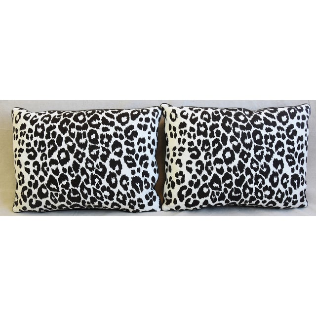 """Pair of custom-tailored pillows in hand-printed Schumacher """"Iconic Leopard ll"""" linen fabric. Dark-brown Italian tanned..."""