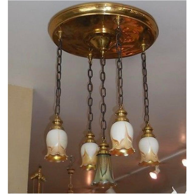 This lovely chandelier is a genuine antique in elegant polished brass with iron chains and important glass shades. It is...