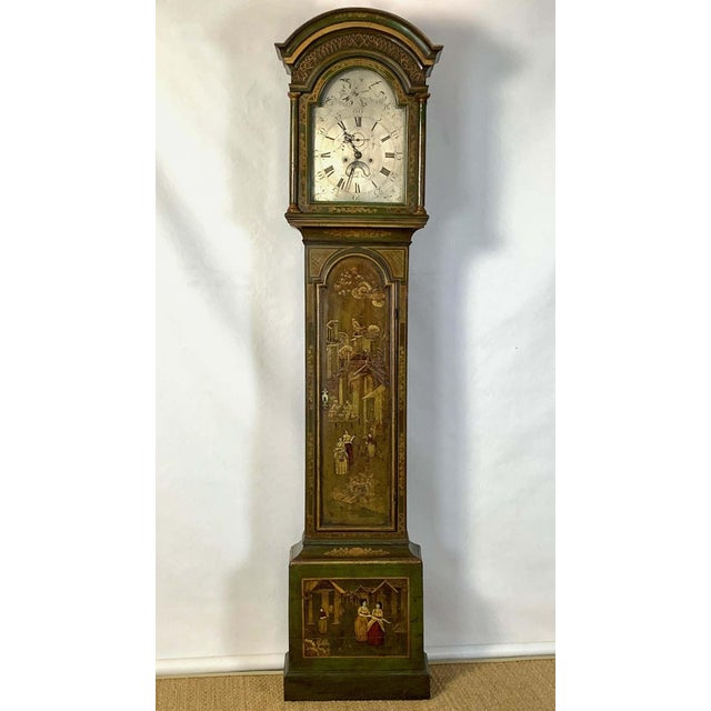 A late 18th century English 8-day tall case clock by Woodley, Kington. The elegant green painted chinoiserie decorated...