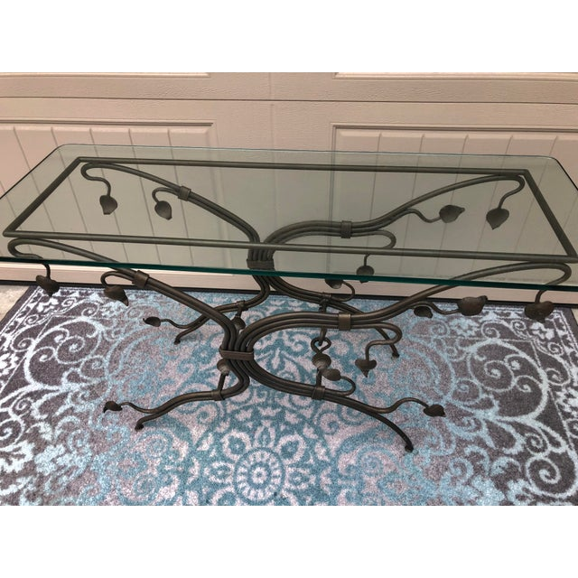 The graceful design of this gorgeous console table is breathtaking. Heavy iron vines and leaves gracefully hold the 1/2...