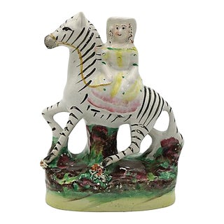 Antique Staffordshire Girl Riding Zebra