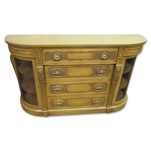 This piece has plenty of storage for all your dining pieces. It will make a great addition to your elegant living space!
