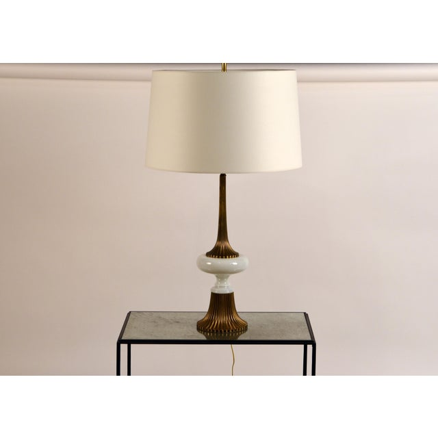 Elegant gilt bronze and white opaline Hollywood Regency lamp in the style of Tony Duquette. Custom paper shade (19 in....